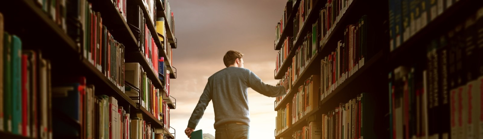 Teen walking in book stacks